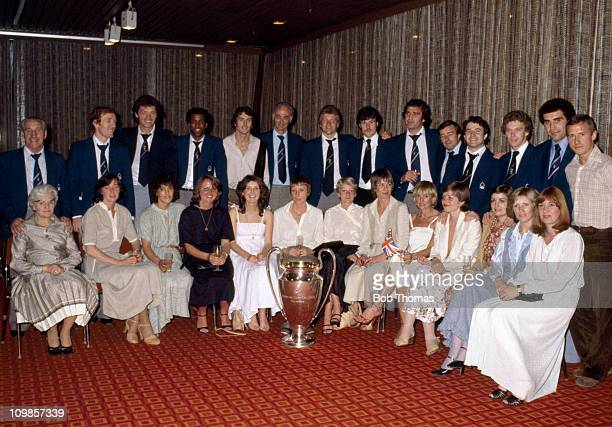 The Nottingham Forest players and their wives pose for a unique team photograph with the trophy at their hotel after victory over Malmo in the...