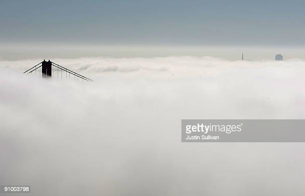 The nouth tower of the Golden Gate Bridge and the top of the San Francisco skylines peeks out from a blanket of fog September 21 2009 in the Marin...