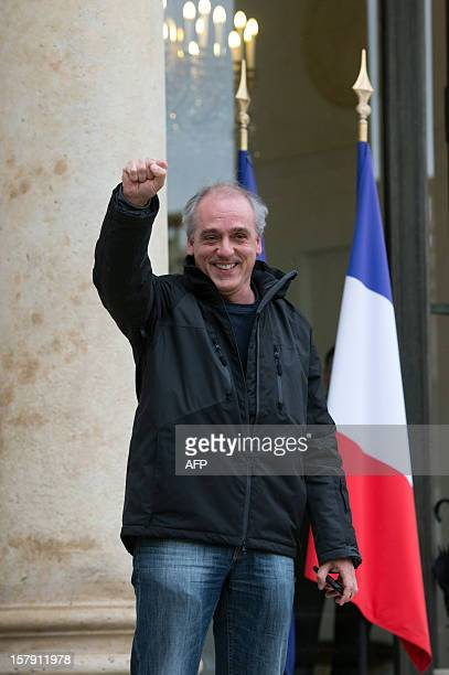 The Nouveau parti anticapitaliste far left party Philippe Poutou gestures as he leaves a meeting with France's President at the Elysee presidential...