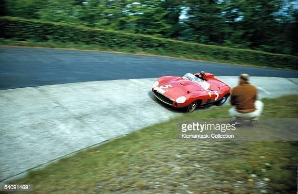 The Nürburgring 1000km Race Nürburgring May 26 1957 Peter Collins wheels the 335 Sport Ferrari which he shared with Olivier Gendebien through the...