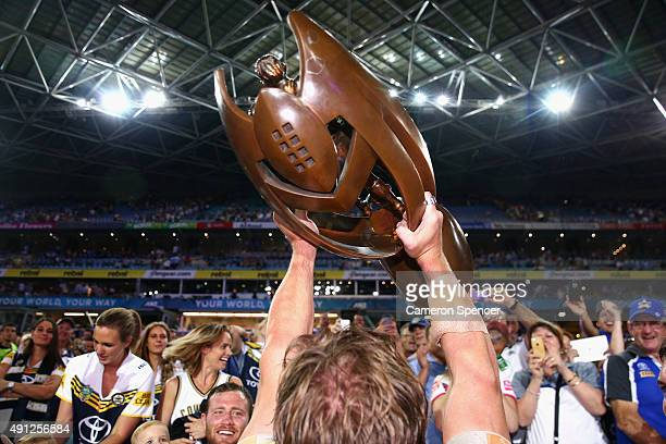 The NRL Premiership trophy is held aloft by a Cowboys player after winning the 2015 NRL Grand Final match between the Brisbane Broncos and the North...