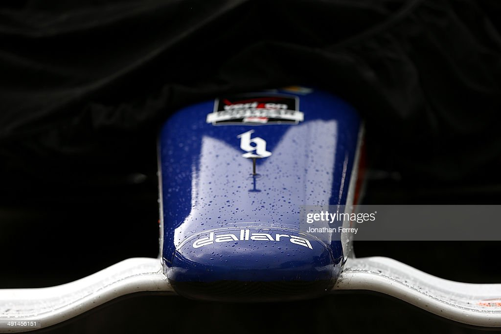 The #8 NTT DATA Chip Ganassi Racing Chevrolet Dallara, driven by Ryan Briscoe of Australia, sits draped in a rain cover in the pits during practice for the 98th Indianapolis 500 Mile Race on May 16, 2014 at the Indianapolis Motor Speedway in Indianapolis, Indiana.