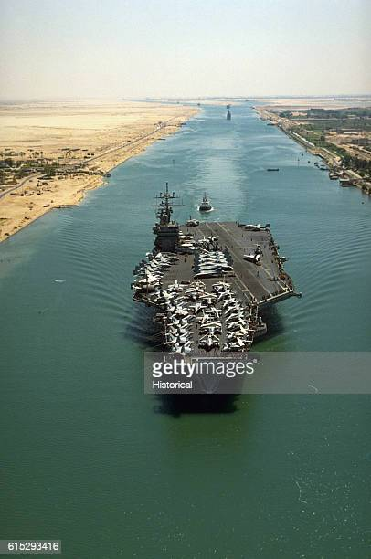 The nuclearpowered aircraft carrier USS Dwight D Eisenhower transits the Suez Canal en route to the Mediterranean Sea following a deployment in...