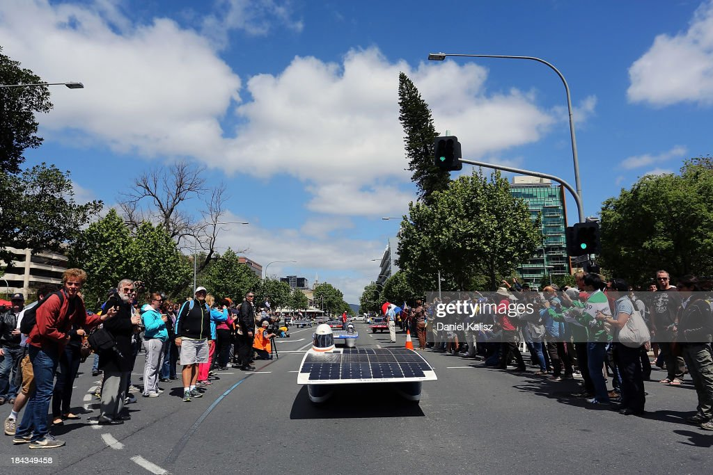 The NUNA7, Nuon Solar Team of the Delft University of Technology, Challenger Class from the Netherlands takes part in the 2013 World Solar Challenge street parade on October 13, 2013 in Adelaide, Australia. Over 25 teams from across the globe competed in the 2013 World Solar Challenge, a 3000 km solar-powered vehicle race between Darwin and Adelaide, which was won by Dutch team Nuon from the Delft University of Technology.