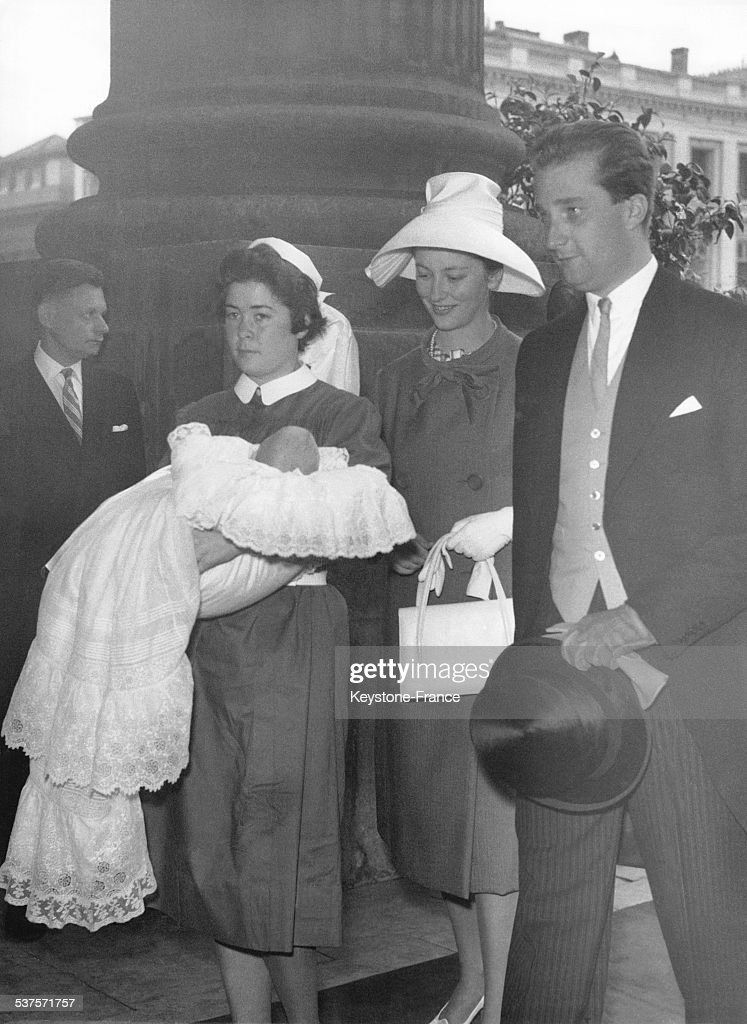 The nurse carries Prince Philippe followed by Prince Albert and Princess Paola for the baptism of Philip at the church Saint-Jacques sur Coudenberg on May 18, 1960 in Brussels, Belgium.