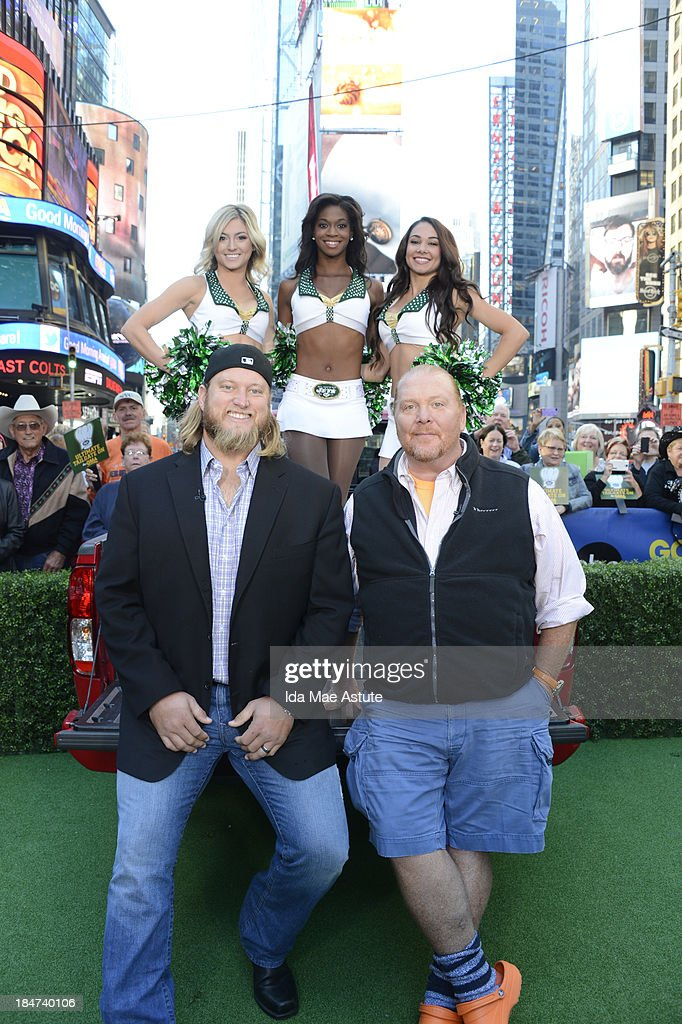 AMERICA - The NY Jets Flight Crew, Nick Mangold and chef Mario Batali tailgate in Times Square on GOOD MORNING AMERICA, 10/15/13, airing on the ABC Television Network. (Photo by Ida Mae Astute/ABC via Getty Images) NICK