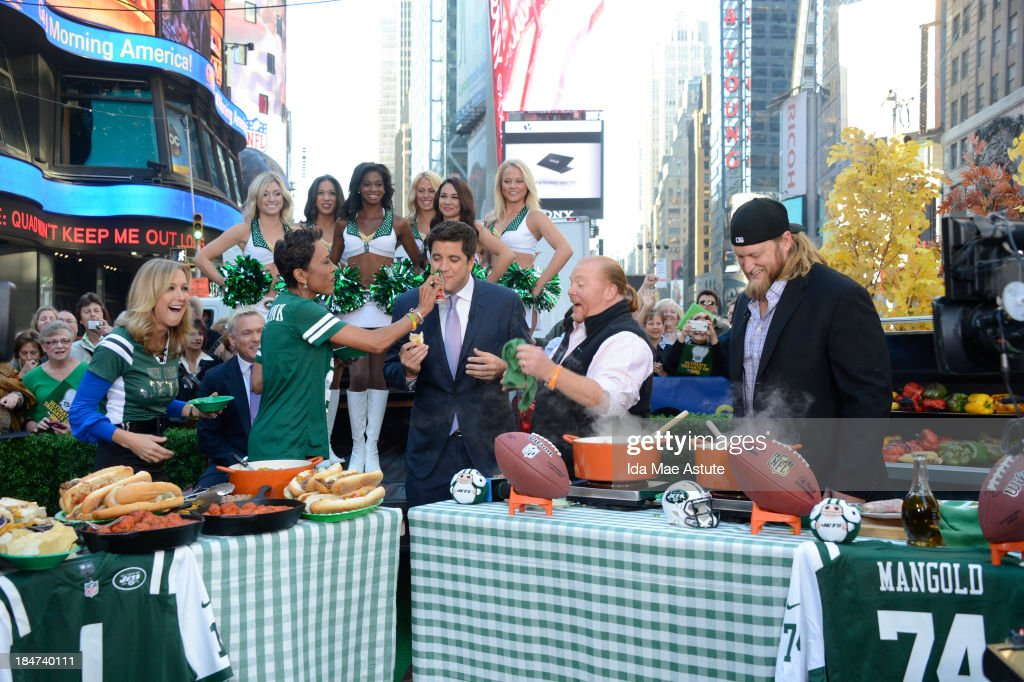 AMERICA - The NY Jets Flight Crew, Nick Mangold and chef Mario Batali tailgate in Times Square on GOOD MORNING AMERICA, 10/15/13, airing on the ABC Television Network. (Photo by Ida Mae Astute/ABC via Getty Images) LARA