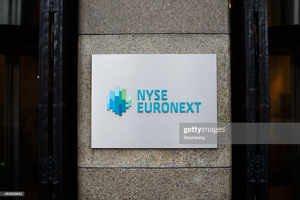 The NYSE Euronext logo, a unit of IntercontinentalExchange Group Inc. (ICE), sits on a sign outside the Amsterdam Stock Exchange, in Amsterdam, Netherlands, on Tuesday, Jan. 14, 2014. ICE plans to sell as much as 30 percent of Euronext NV before the operator of the Paris and Amsterdam exchanges goes public this year, three people with knowledge of the matter said. Photographer: Jasper Juinen/Bloomberg via Getty Images