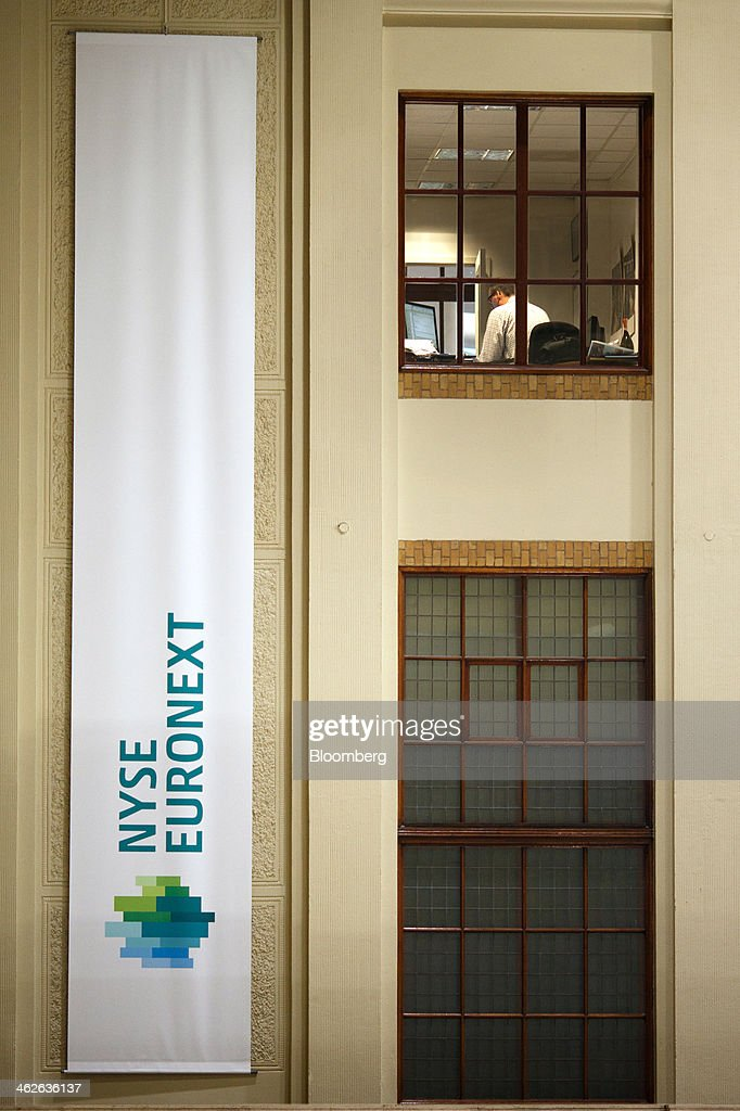 The NYSE Euronext logo sits on a banner inside the Amsterdam Stock Exchange, operated by Euronext NV, a unit of IntercontinentalExchange Group Inc. (ICE), in Amsterdam, Netherlands, on Tuesday, Jan. 14, 2014. ICE plans to sell as much as 30 percent of Euronext NV before the operator of the Paris and Amsterdam exchanges goes public this year, three people with knowledge of the matter said. Photographer: Jasper Juinen/Bloomberg via Getty Images
