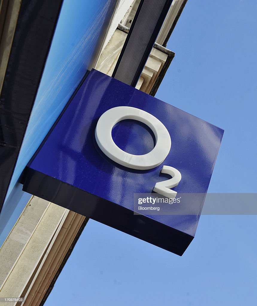 The O2 company logo is displayed on a sign in front of an O2 Mobile Phone Store, part of Telefonica SA, on Grafton Street in Dublin, Ireland, on Wednesday, June 12, 2013. Telefonica SA, Europe's most indebted telephone company, is seeking initial bids for its Irish unit within the month, two people with knowledge of the matter said. Photographer: Aidan Crawley/Bloomberg via Getty Images