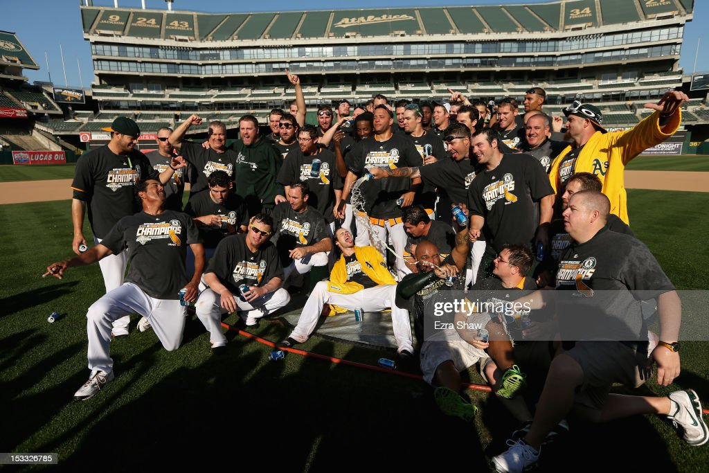 The Oakland Athletics pose for a team photo after they beat the Texas Rangers to win the American League West Division title at O.co Coliseum on October 3, 2012 in Oakland, California.