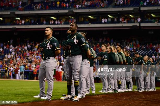 The Oakland Athletics stand during the national anthem before taking on the Philadelphia Phillies at Citizens Bank Park on September 16 2017 in...
