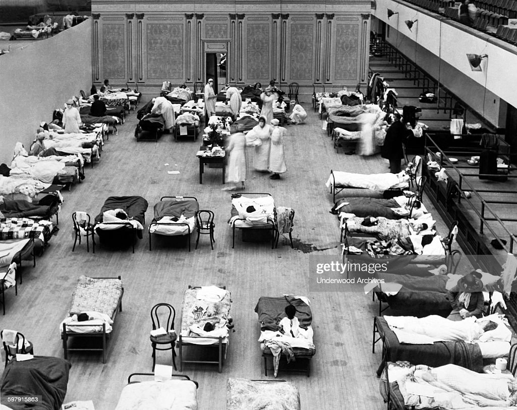 The Oakland Municipal Auditorium is being used as a temporary hospital with volunteer nurses from the American Red Cross tending the sick there...