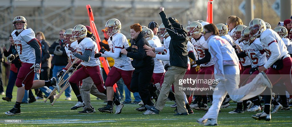 The Oakton Bench and fans storm the field after they beat Westfield 23 - 16 in the Virginia AAA Northern Region Division 6 final at Westfield High School in Chantilly VA, November 24, 2012 .