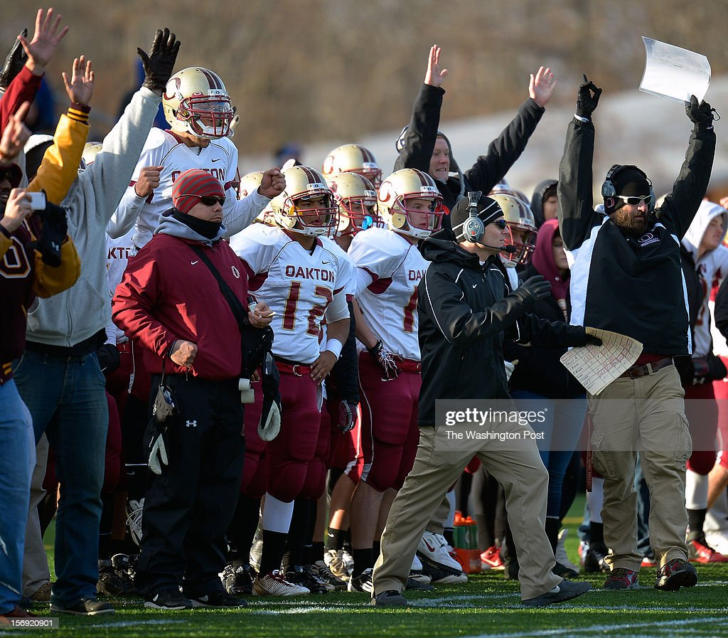 The Oakton sideline celebrates a 4th quarter touchdown during Westfield loss to Oakton 23 - 16 in the Virginia AAA Northern Region Division 6 final at Westfield High School in Chantilly VA, November 24, 2012 .