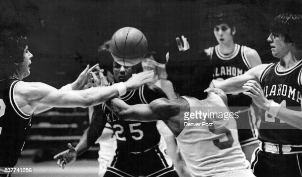 The Object of Everyone's Attention Four members of the University of Oklahoma basketball team and Colorado's Tony Lawrence discover the ball right in...