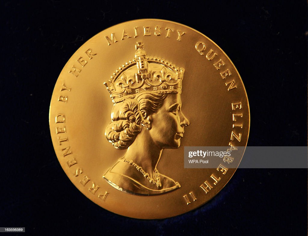 The obverse side of the Queen's Gold Medal for Poetry as Queen Elizabeth II (not pictured) holds a audience with the Queen's Gold Medal for Poetry winner Mr John Agard, at Buckingham Palace, on March 12, 2013 in London, England.