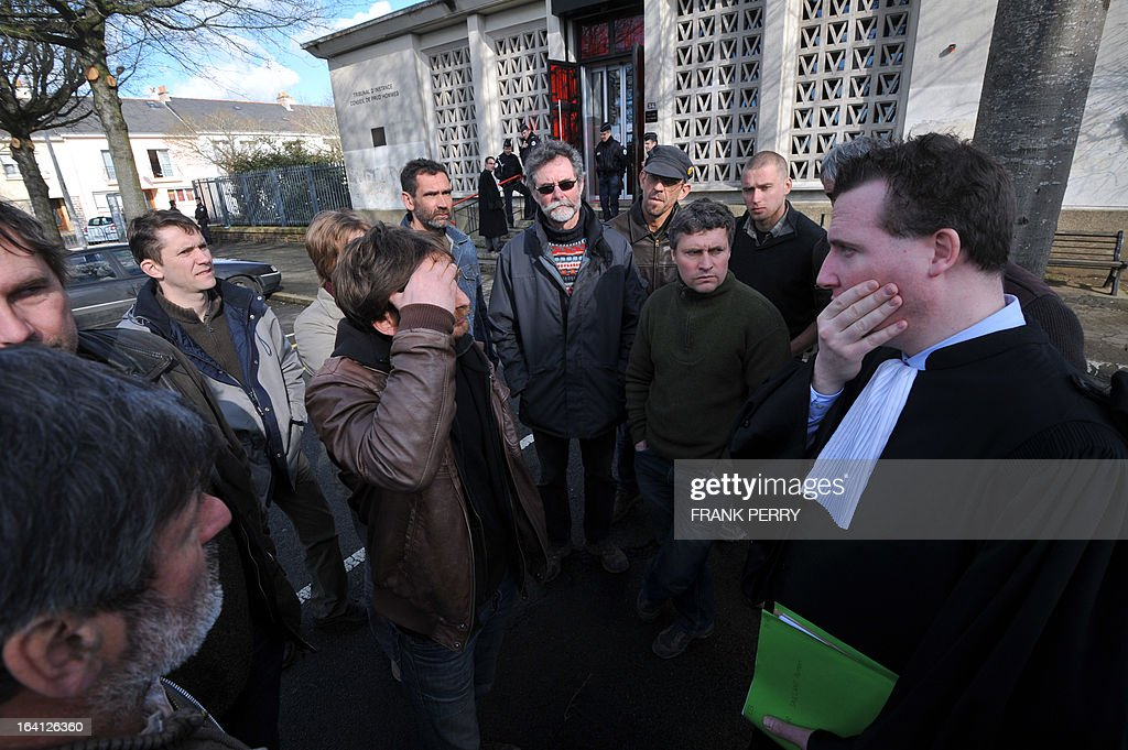 The occupants of the Bellevue farm talk on March 20, 2013 with their lawyer Etienne Boittin after appearing at the Saint-Nazaire courthouse in their ongoing lawsuit against the building of the Notre-Dame des Landes airport. The occupants are facing a potential expulsion on March 21.