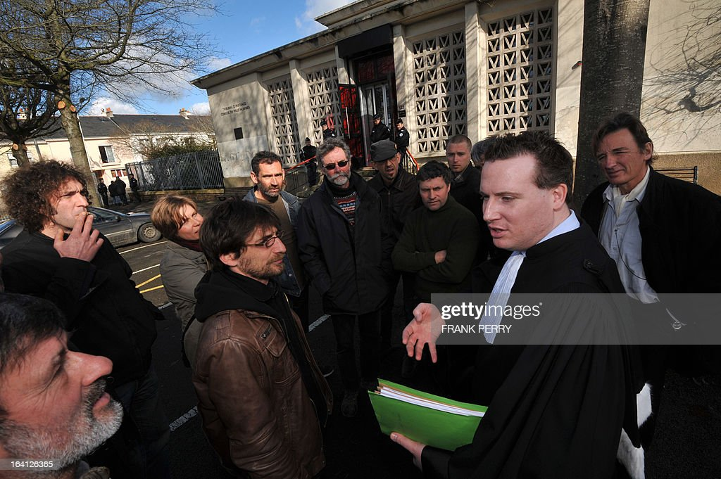 The occupants of the Bellevue farm talk on March 20, 2013 with their lawyer Etienne Boittin (C) after appearing at the Saint-Nazaire courthouse in their ongoing lawsuit against the building of the Notre-Dame des Landes airport. The occupants are facing a potential expulsion on March 21.