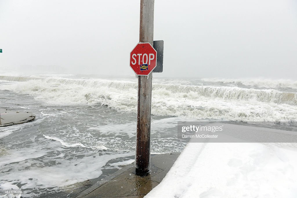 The ocean overflows the sea wall on Winthrop Shore Drive February 9, 2013 in Winthrop, Massachusetts. An overnight blizzard left one to two feet of snow in areas, and coastal flooding is expected as the storm lingers into the day.