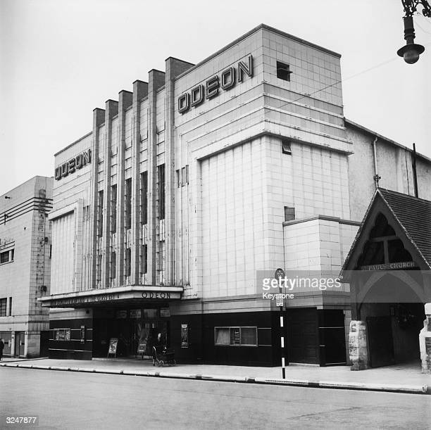 The Odeon cinema in Brighton which is showing 'The Glass Key' starring Brian Donlevy and Alan Ladd Next door is the wooden entrance to St Paul's...