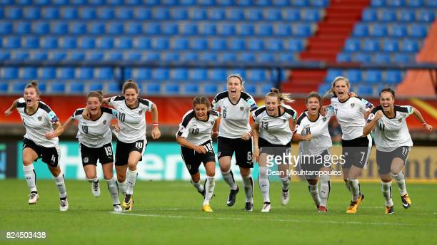 The of Austria team celebrate victory after a peanlty shoot out after the UEFA Women's Euro 2017 Quarter Final match between Austria and Spain at...