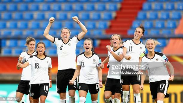 The of Austria team celebrate winning a penalty shoot out after the UEFA Women's Euro 2017 Quarter Final match between Austria and Spain at Koning...