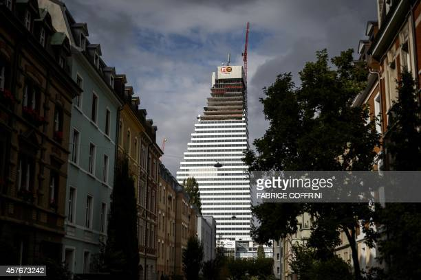 The office building 1of Swiss pharmaceutical giant Roche is seen during its construction on October 22 2014 in Basel When completed in 2015 the...