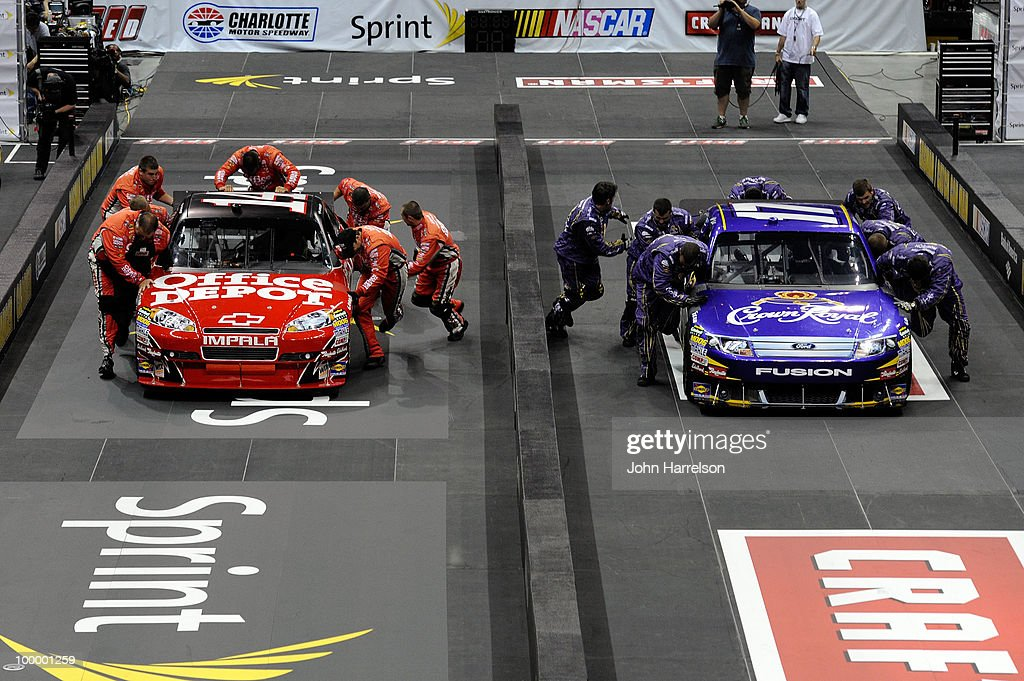 The #14 Office Depot Chevrolet pit crew races the #17 Crown Royal Ford pit crew during the NASCAR Sprint Pit Crew Challenge at Time Warner Cable Arena on May 19, 2010 in Charlotte, North Carolina.