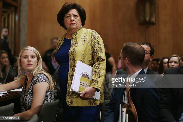 The Office of Personnel Management Director Katherine Archuleta arrives late for a hearing of the Senate Homeland Security and Governmental Affairs...