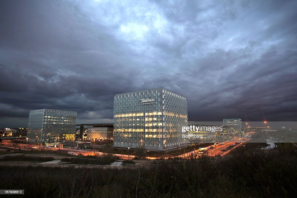 The office space at the Telefonica SA headquarters is seen illuminated by light as traffic passes outside the building in the late evening in Madrid, Spain, on Tuesday, April 30, 2013. Telefonica SA, Spain's largest phone company, is considering sale options in Europe that range from fixed-line operations in Germany to its assets in Ireland, according to people familiar with the plans. Photographer: Angel Navarrete/Bloomberg via Getty Images