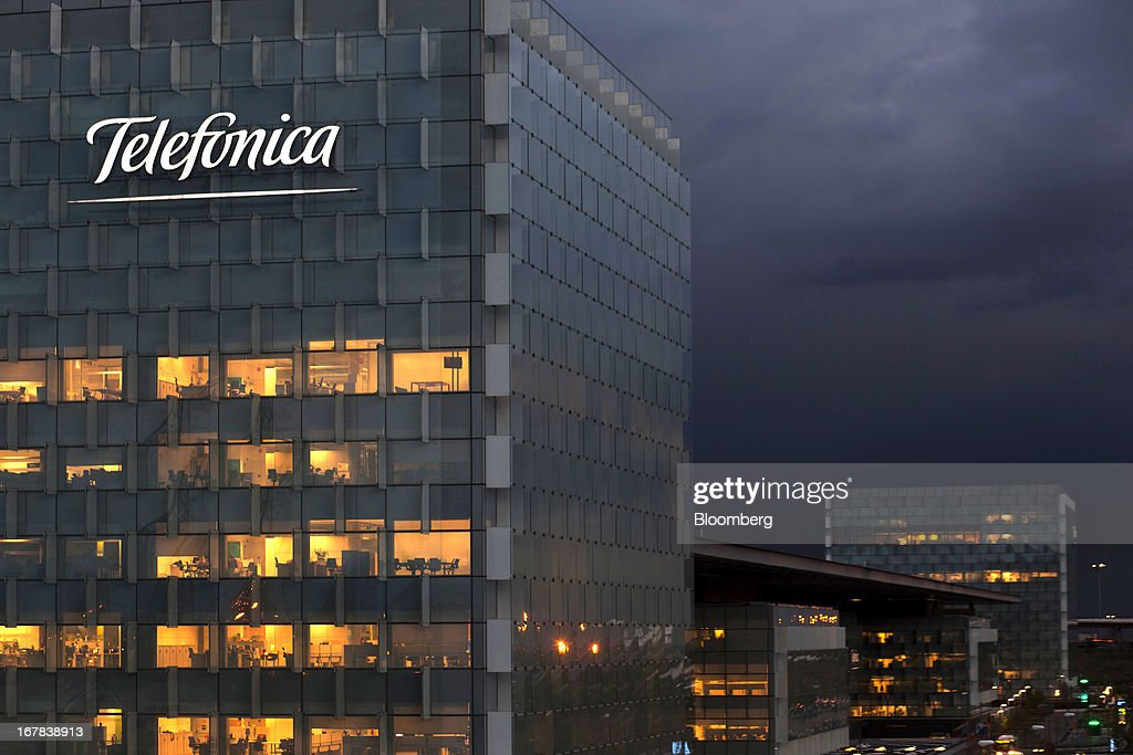 The office space at the Telefonica SA headquarters is seen illuminated by light in the late evening in Madrid, Spain, on Tuesday, April 30, 2013. Telefonica SA, Spain's largest phone company, is considering sale options in Europe that range from fixed-line operations in Germany to its assets in Ireland, according to people familiar with the plans. Photographer: Angel Navarrete/Bloomberg via Getty Images