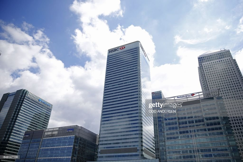 The offices of Barclays, KPMG, HSBC and Bank of America, are pictured in the Canary Wharf financial district of east London on June 26, 2016. British business minister Sajid Javid on Sunday urged companies not to panic following Britain's vote to leave the European Union (EU) despite dire warnings of the economic consequences of the Brexit vote. 'Our economic fundamentals remain strong. They're strong enough to weather any short-term market volatility,' he said, after Thursday's vote plunged global financial markets and the value of the pound. / AFP / ODD