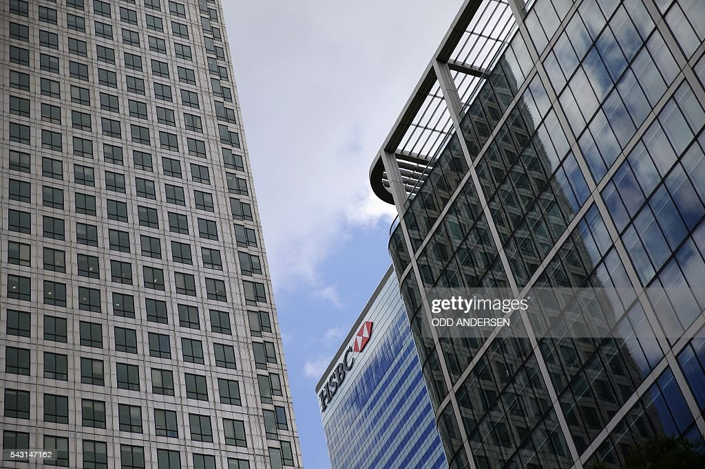 The offices of HSBC are pictured in the Canary Wharf financial district of east London on June 26, 2016. British business minister Sajid Javid on Sunday urged companies not to panic following Britain's vote to leave the European Union (EU) despite dire warnings of the economic consequences of the Brexit vote. 'Our economic fundamentals remain strong. They're strong enough to weather any short-term market volatility,' he said, after Thursday's vote plunged global financial markets and the value of the pound. / AFP / ODD