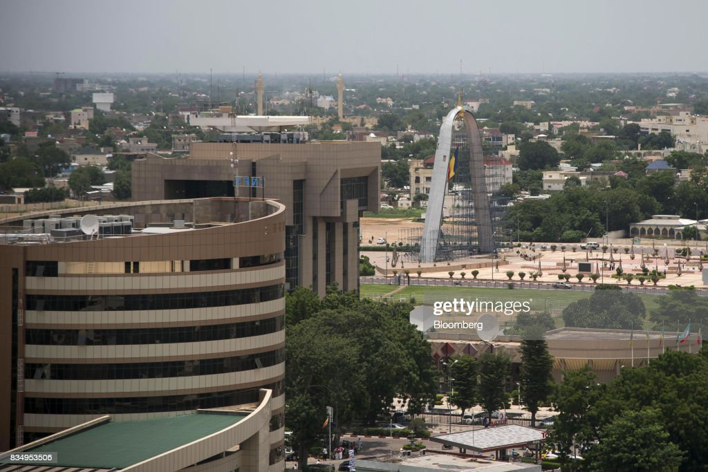 The offices of the Caisse Nationale des Prevoyances Sociales, left, the Central Bank of Central African States, center, and the Arch of the Place de la Nation sit on the city skyline in N'Djamena, Chad, on Wednesday, Aug. 16, 2017. African Development Bank and nations signed agreement to finance a project linking the town of Ngouandere in Cameroon and Chads capital, NDjamena, according to statement handed to reporters in Cameroonian capital, Yaounde in July. Photographer: Xaume Olleros/Bloomberg via Getty Images