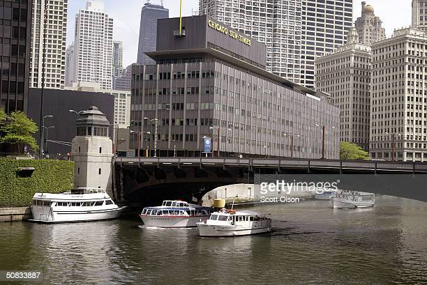 The offices of the Chicago Sun Times newspaper sits along the bank of the Chicago river May 13 2004 in Chicago Illinois The building is slated to be...
