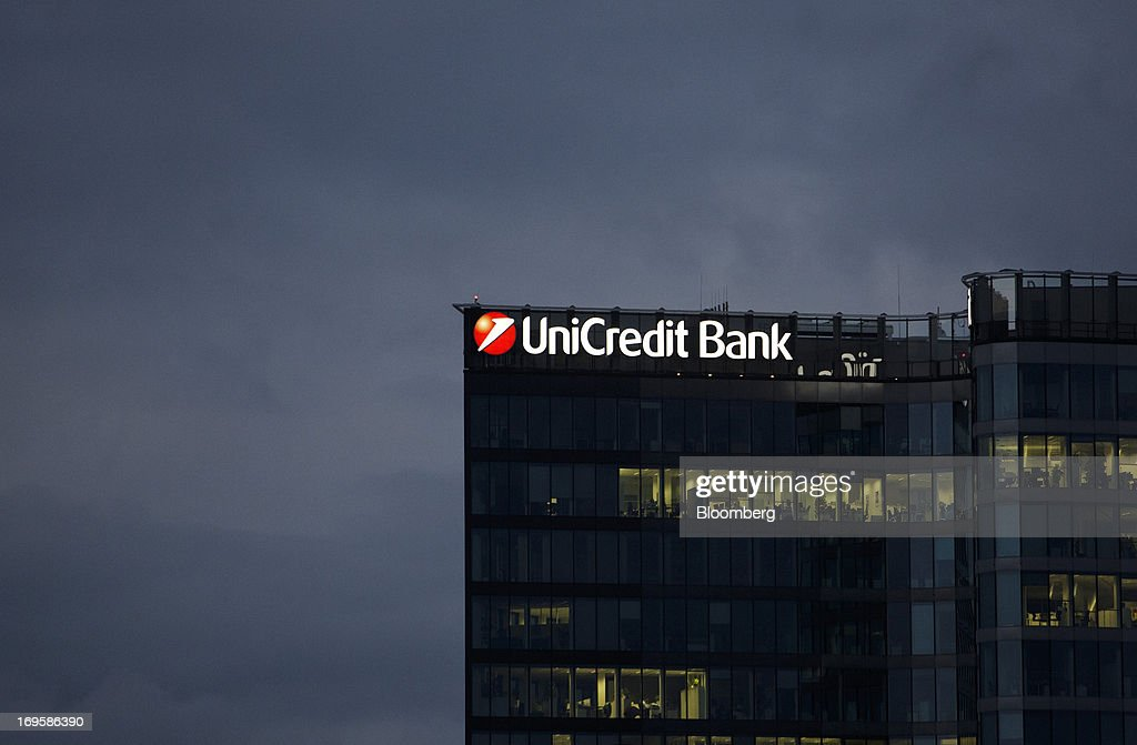 The offices of UniCredit Bank Czech Republic SA stand illuminated at night in Prague, Czech Republic, on Monday, May 27, 2013. Czech policy makers are in uncharted territory as they debate whether the first koruna sales in a decade are needed to meet their inflation target as the economy has shrunk for five quarters, the longest contraction since at least 1996. Photographer: Martin Divisek/Bloomberg via Getty Images
