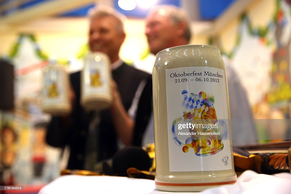 The official 2013 Oktoberfest one-liter beer glass is pictured during a peresentation at Hacker Festzelt on the Theresienwiese three weeks ahead of Oktoberfest on August 27, 2013 in Munich, Germany. Munich Oktoberfest, which opens to the public on September 21, draws millions of visitors and is the biggest beer fest in the world.