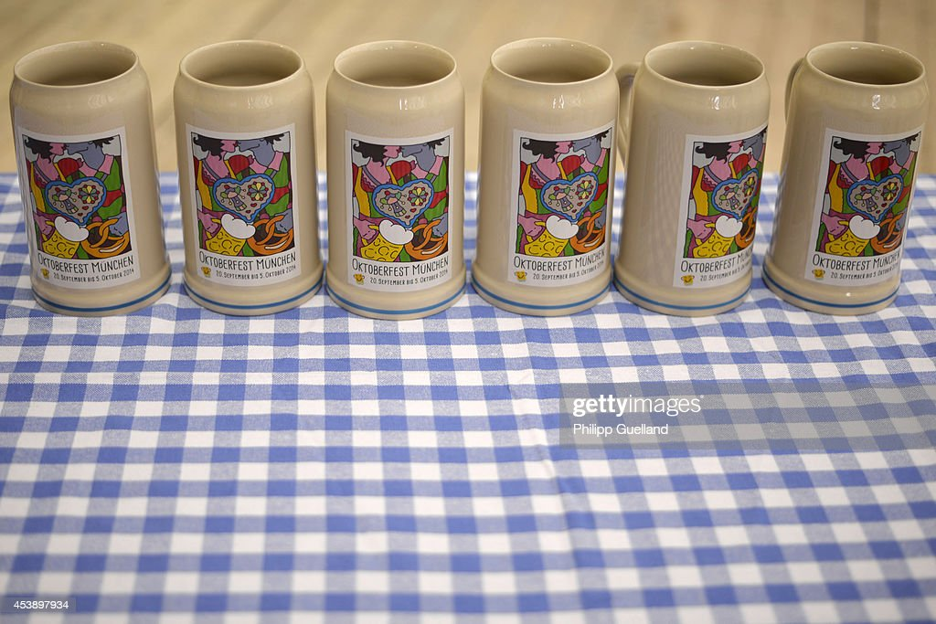The official 2014 Oktoberfest one-liter beer stein is seen during its presentation four weeks ahead of Oktoberfest on August 21, 2014 in Munich, Germany. Munich Oktoberfest, which opens to the public on September 20, draws millions of visitors and is the biggest beer fest in the world. Photo by Philipp Guelland/Getty Images)