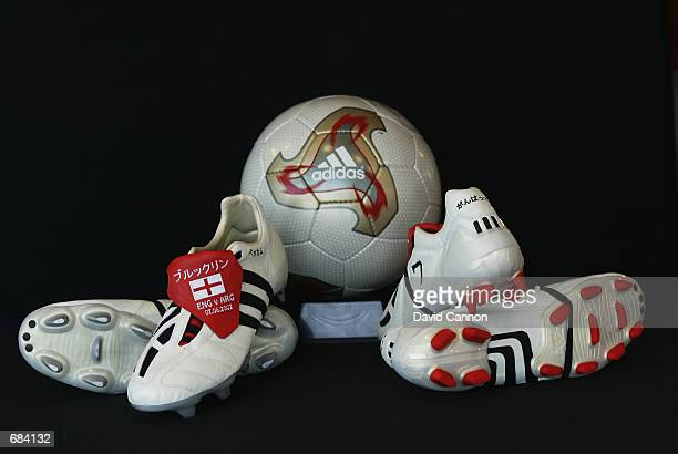 The official adidas Fevernova matchball sits in the middle of David Beckham's adidas boots specially made for the FIFA World Cup Finals 2002 Group F...