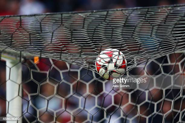 The official adidas match ball Torfabrik hangs is seen on the goal during the Bundesliga match between Eintracht Frankfurt and FC Bayern Muenchen at...