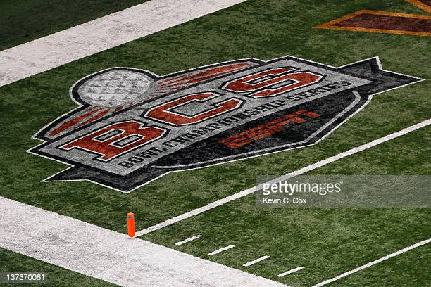 The official Bowl Championship Series logo is seen painted on the turf in the end zone as the Virginia Tech Hokies play against the Michigan...