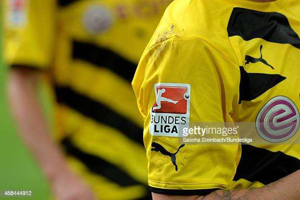 The official 'Bundesliga' logo patch is seen on the jersey sleeves during the Bundesliga match between Borussia Dortmund and Bayer Leverkusen at...