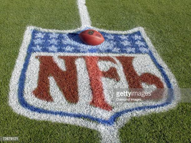 The official football for the National Football League with the signature of new commissioner Roger Goodell sits within the NFL logo painted on the...