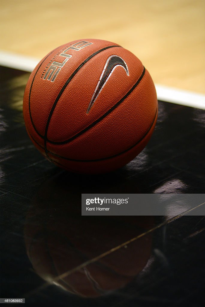 The official game ball is placed on the floor by the referee during a timeout in the game between the San Diego State Aztecs and the UC Riverside...