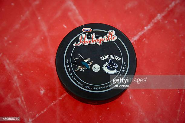 The official Kraft Hockeyville game puck sits on the ice before the game between the Vancouver Canucks and the San Jose Sharks during Day 3 of NHL...