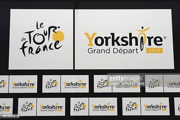 The official logo of the Tour de France and the Yorkshire Grand Depart logo are pictured on July 3 2014 at the press center in Leeds western England...
