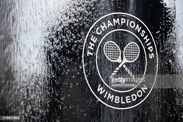 The official logo of the Wimbledon Championships sits on a water feature on day one of the 2015 Wimbledon Championships at The All England Tennis...