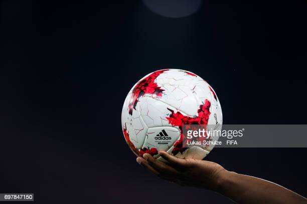 The official match ball is hold by a player during the FIFA Confederations Cup Russia 2017 Group B match between Cameroon and Chile at Spartak...