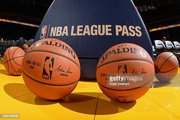 The official NBA Spalding ball sits on the court before the game between the Golden State Warriors and the Houston Rockets on October 15 2015 at...